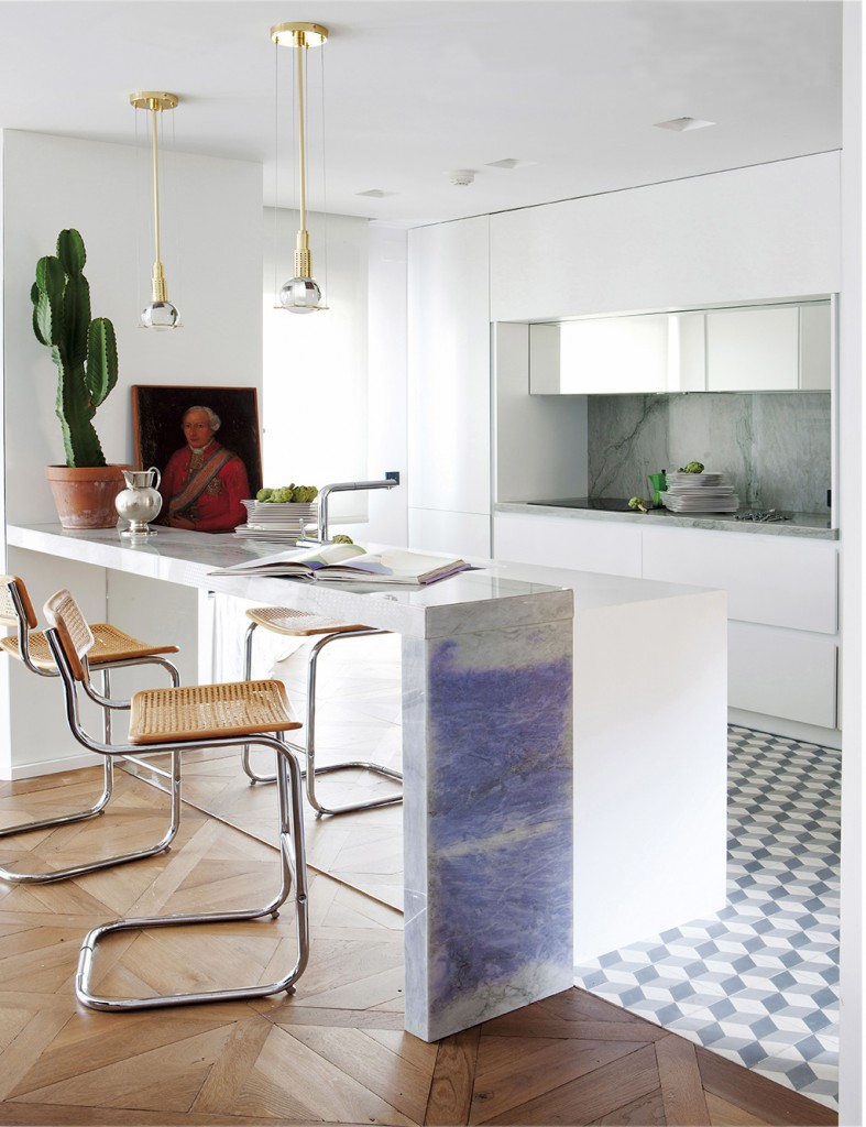 Kitchen with marble island, cactus and old painting, design by Beatriz Silveira