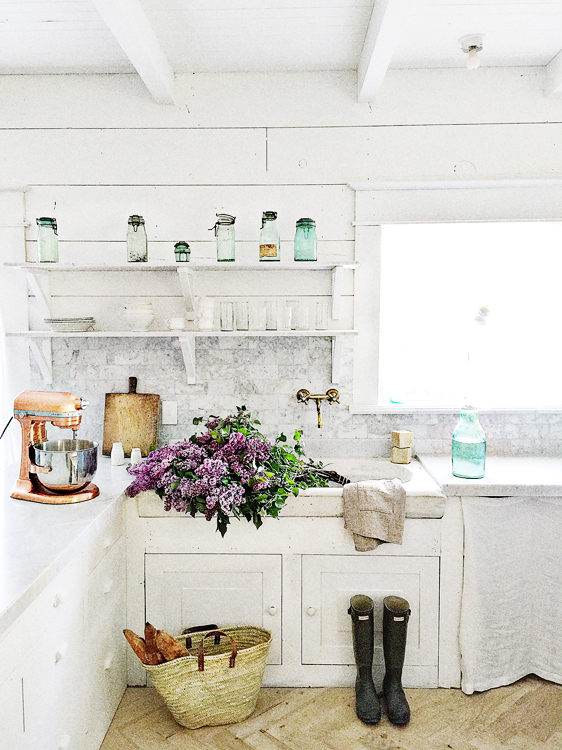 Kitchenaid mixer and marble backsplash french country kitchen