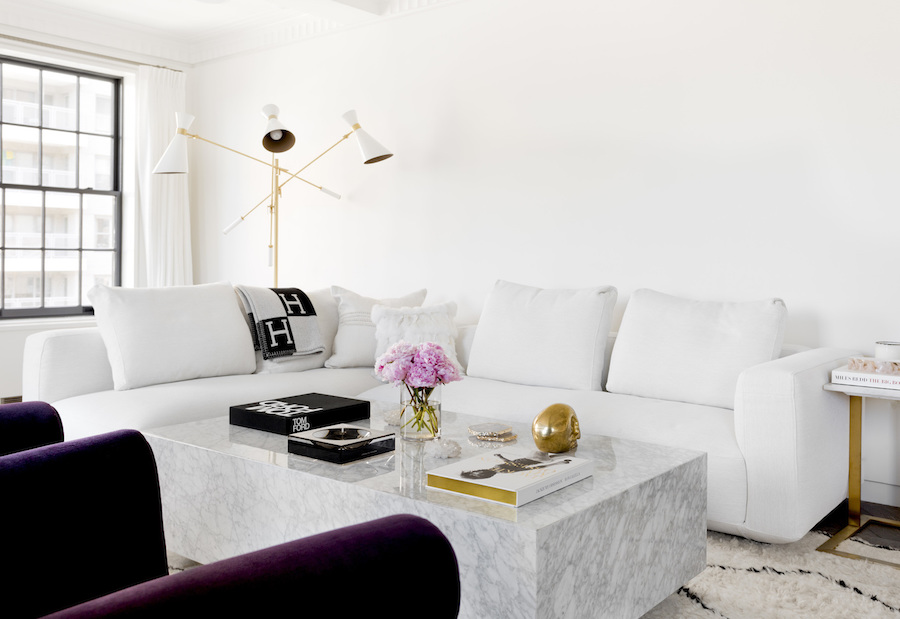 Living room with white sofa and marble block coffee table