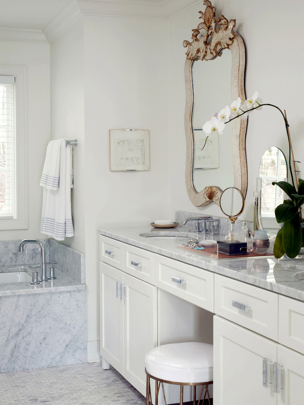 Marble bathroom vanity with ornate mirror
