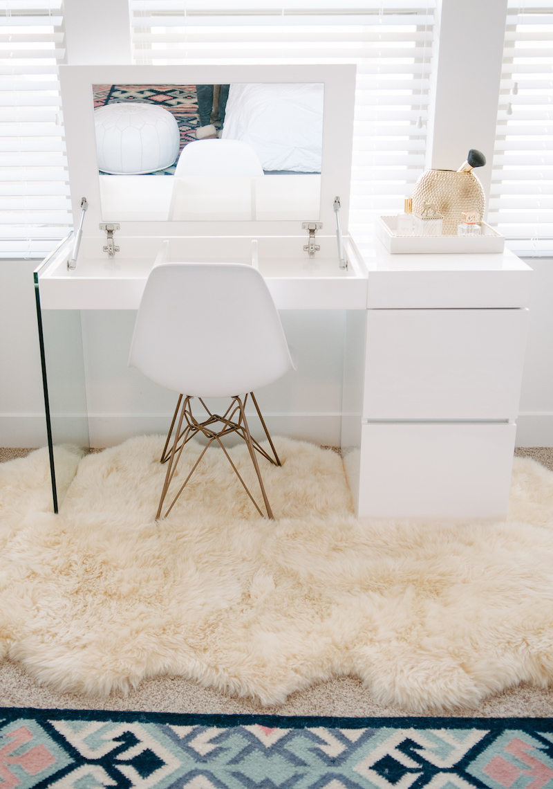 Minimal white vanity with pull open mirror