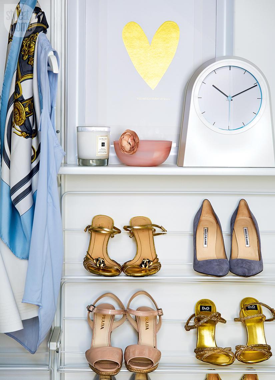 Open shoe shelving in walk-in closet
