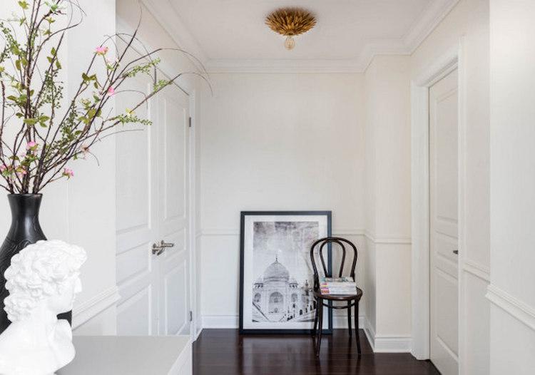 Parisian artwork white hallway
