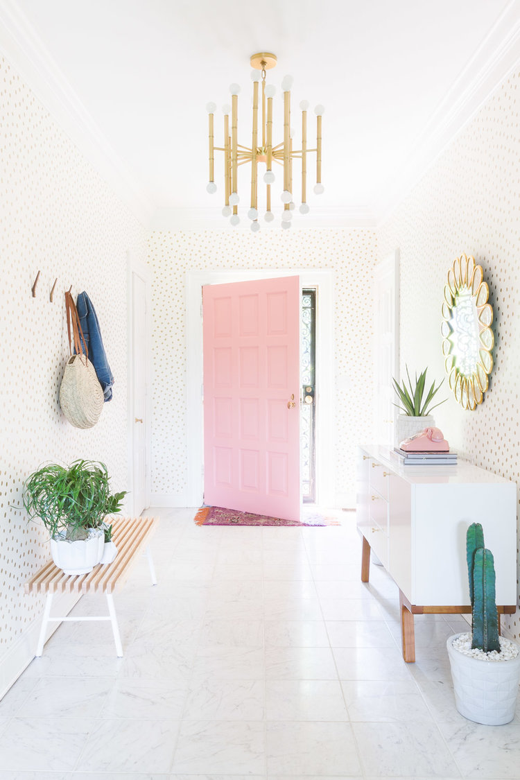Pastel Pink Door Entryway with cactus and gold polka dot wallpaper via Alyssa Rosenheck