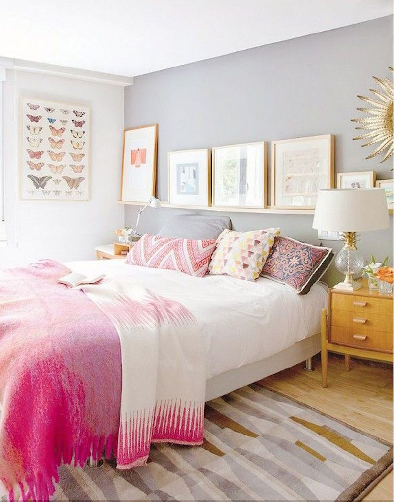 Pink bed with eclectic throw pillows
