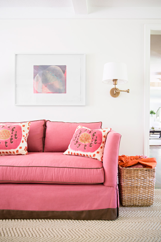 Pink couch with matching pink pillows