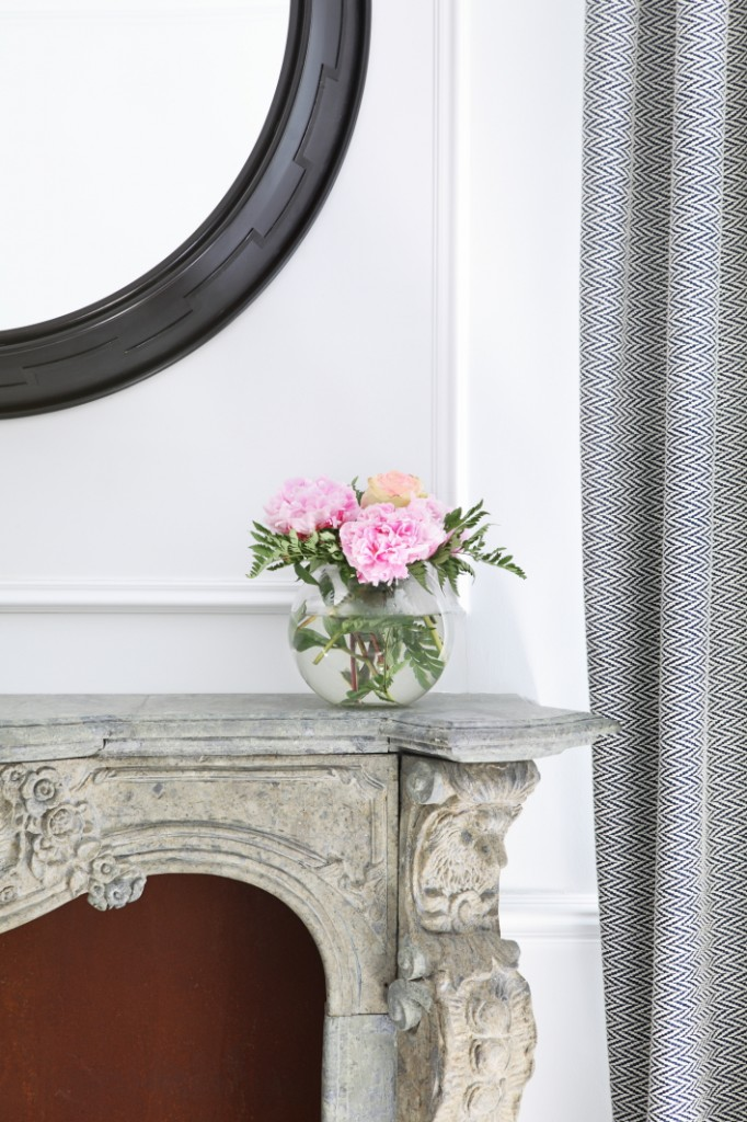Pink peonies on old fireplace, design by Kitchen with marble island, cactus and old painting, design by Beatriz Silveira
