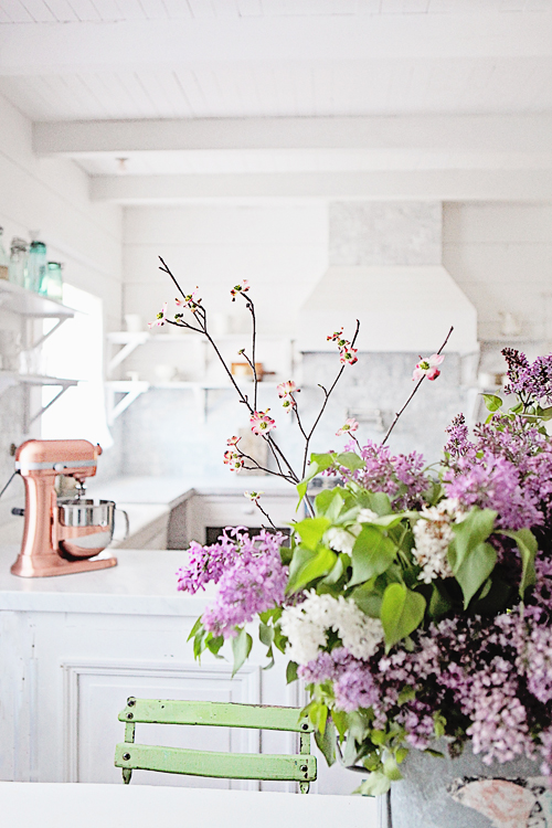 Purple flowers in french country kitchen