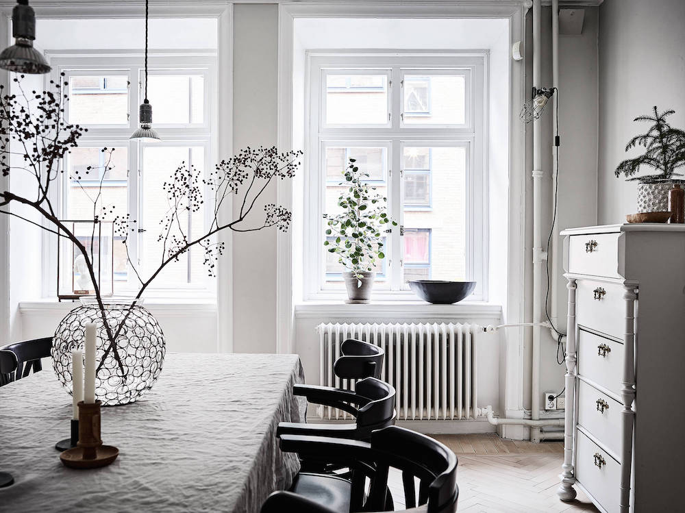 Scandinavian dining room with vintage chest