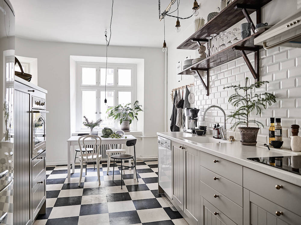 Scandinavian kitchen with black and white tiling