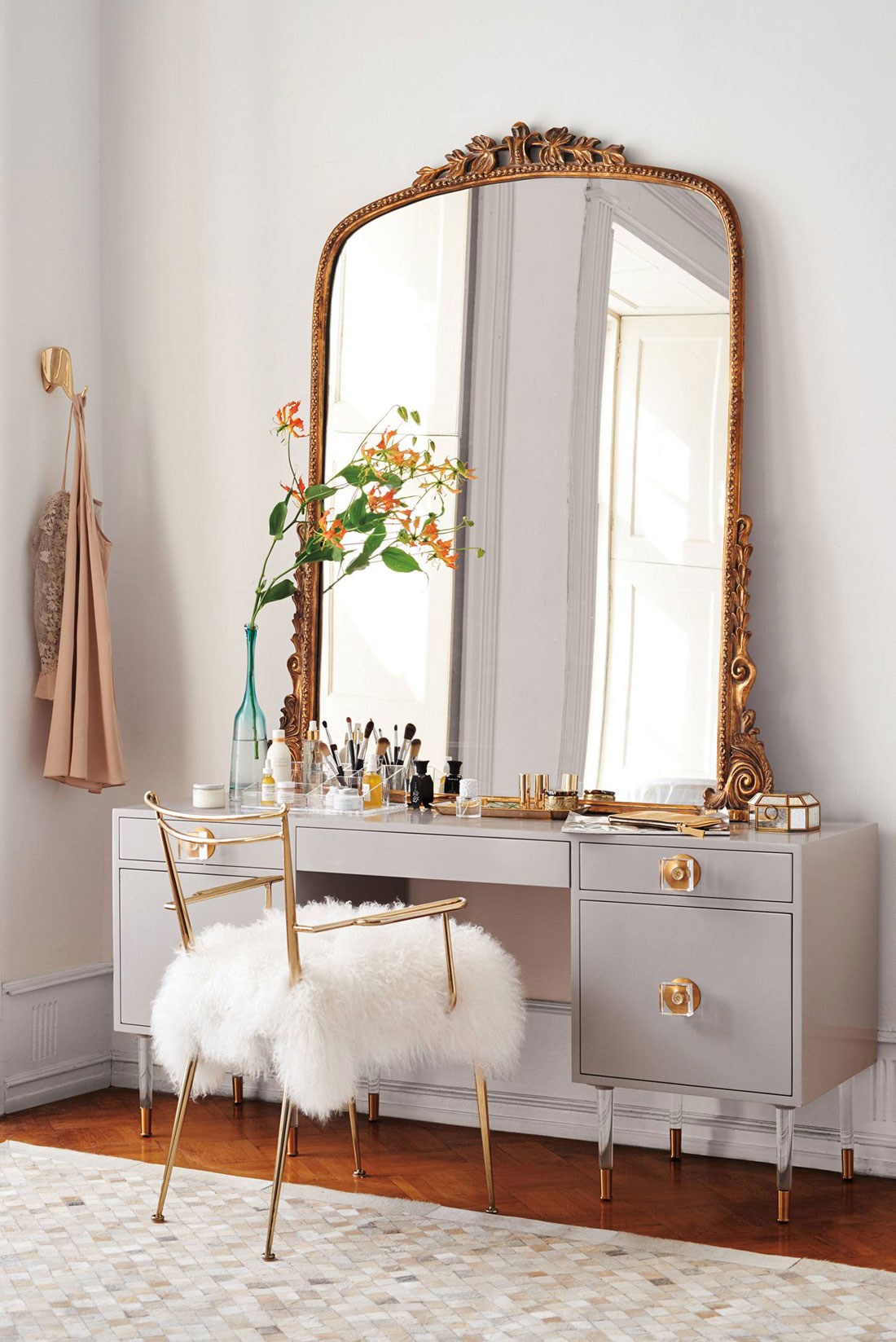 Small grey vanity with oversized vintage gold mirror