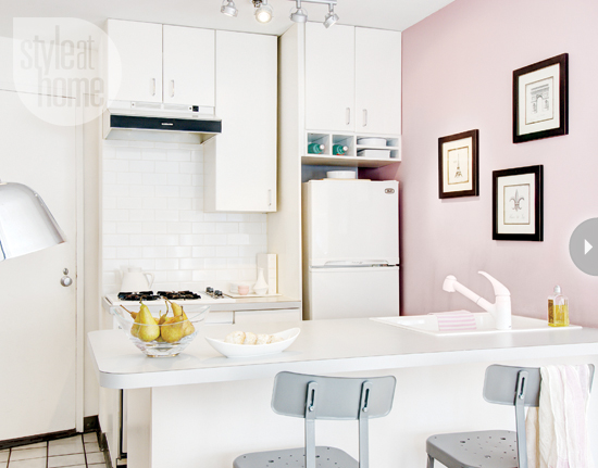 Small white kitchen with pink accent wall