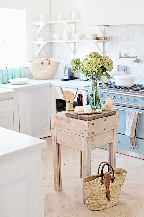 Small wooden island in french country kitchen
