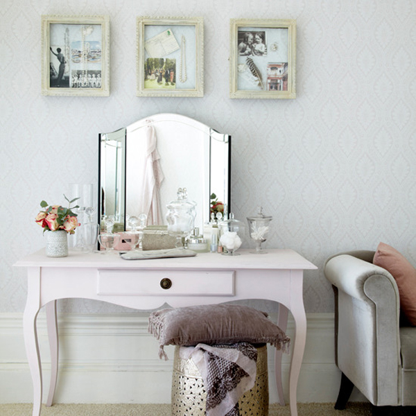 Soft pink vanity with trifold mirror
