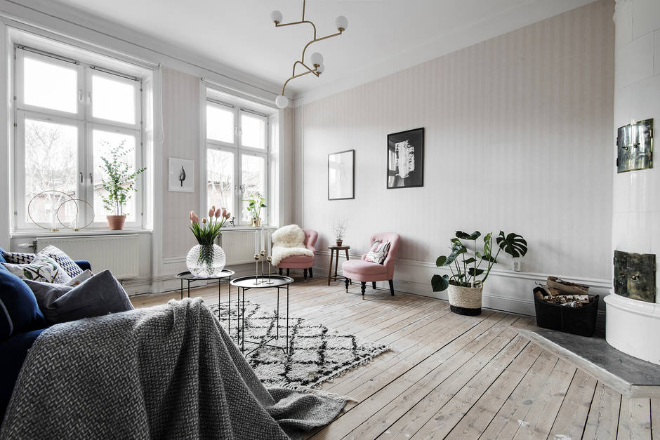Stockholm living room with vintage pink chairs and white fireplace