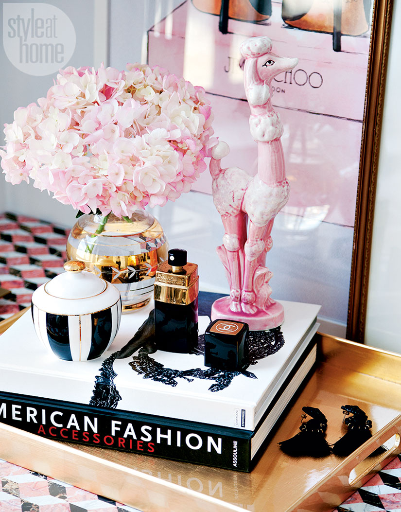 Styling with fashion books, flowers and make up