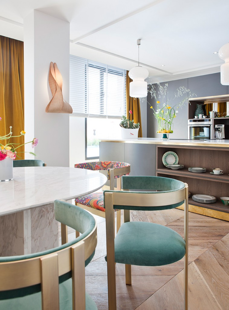 Turquoise dining room chairs, design by Beatriz Silveira