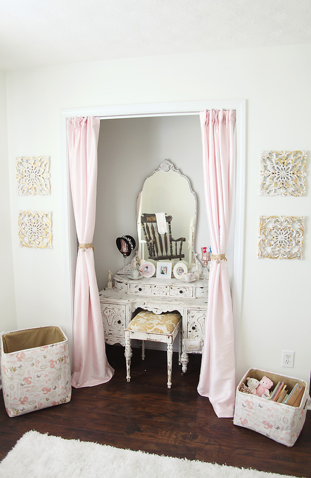 Vanity desk tucked away with pink curtains via Project Nursery
