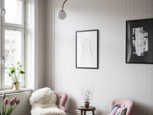 A Stockholm Apartment with Vintage Fireplaces & Pink Chairs