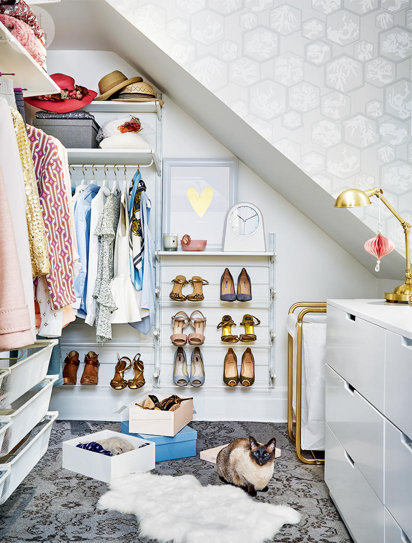 Walk-in closet with open racks and grey wallpaper