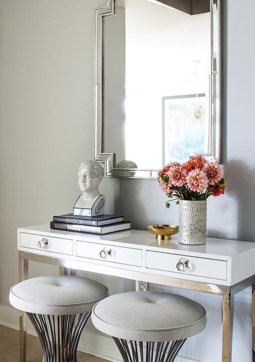 White 3 Drawer Console Table with Gray Button Tufted Stools at Entryway