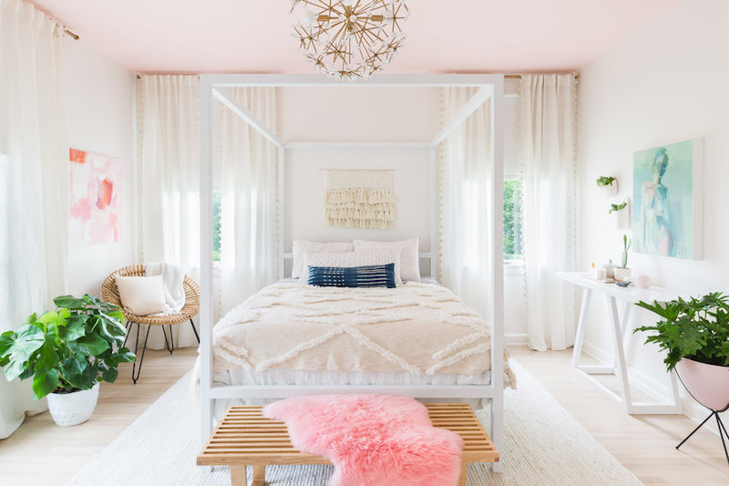 White canopy bed in room with pink ceiling by Alyssa Rosenheck
