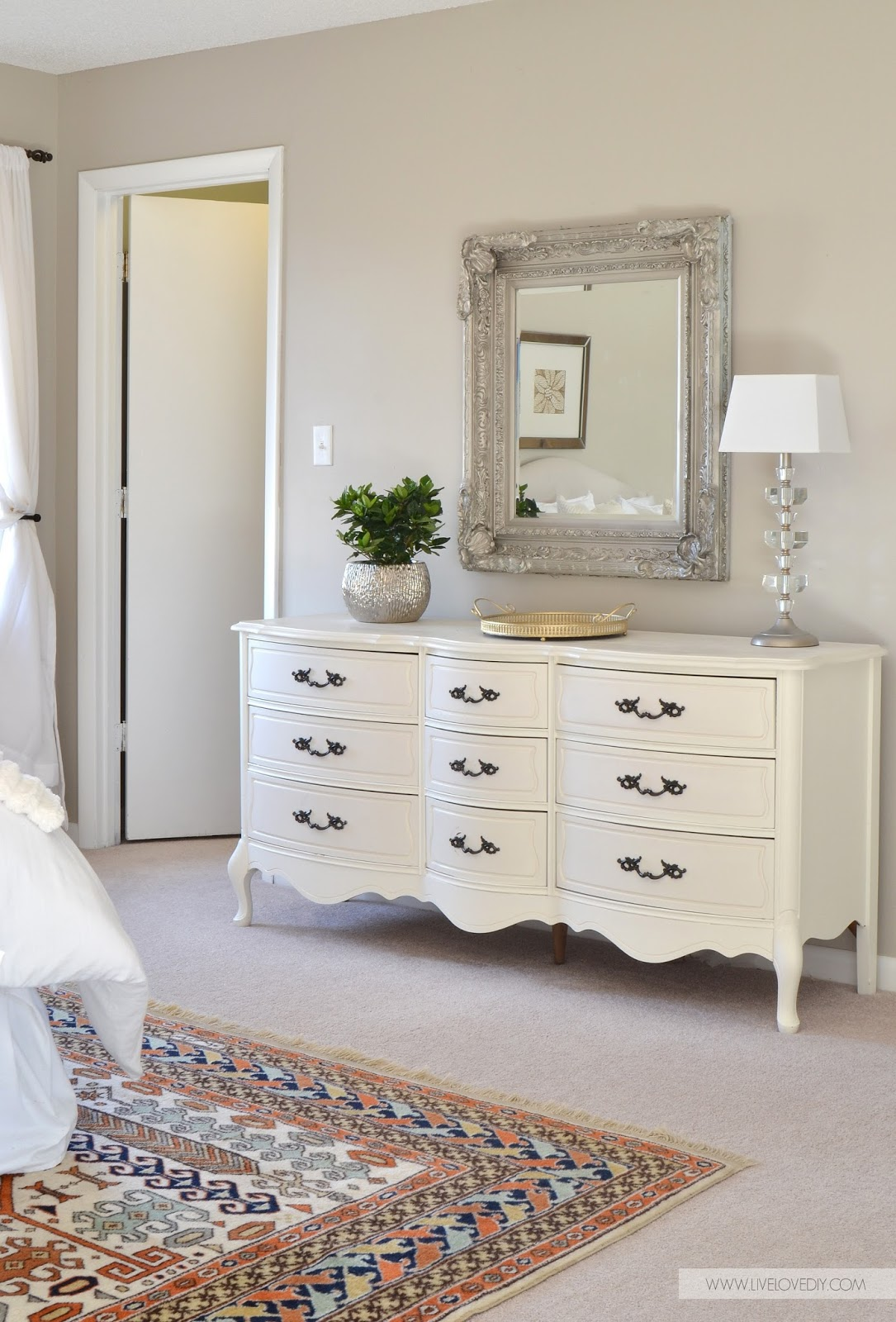 White glamorous vintage dresser in bedroom