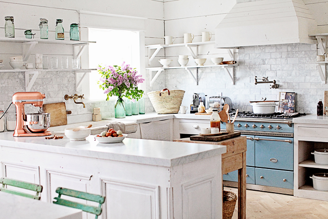 White marble counters in french kitchen with blue stove