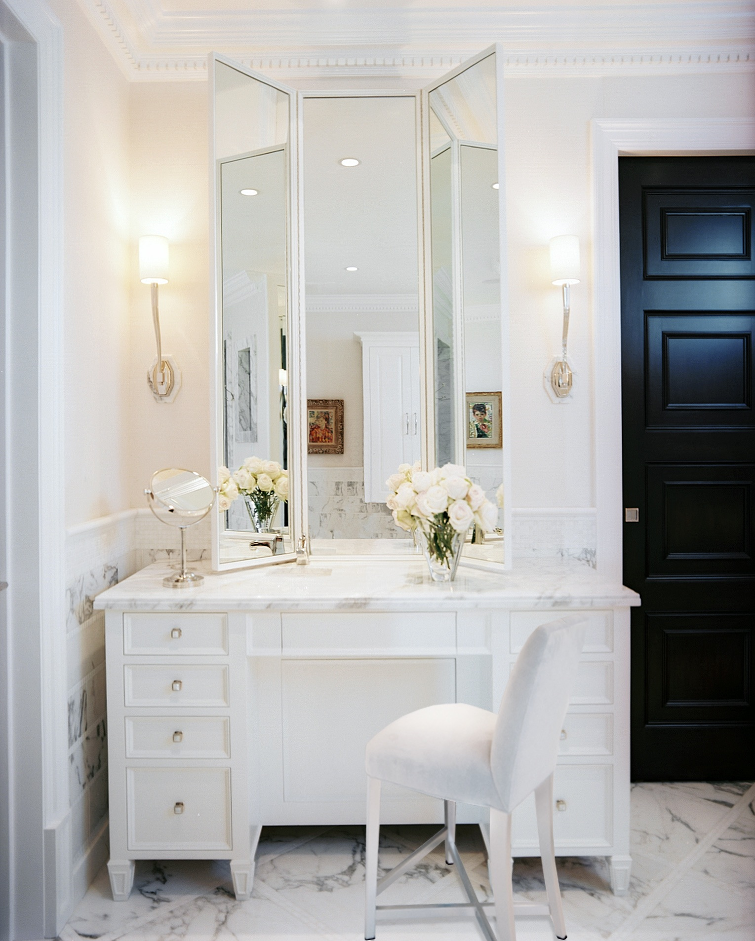 White marble vanity with trifold mirror