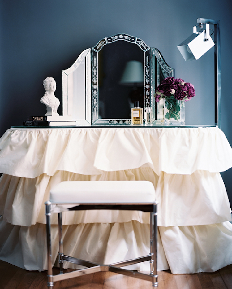 White ruffle vanity with trifold venetian mirror via Patrick Cline