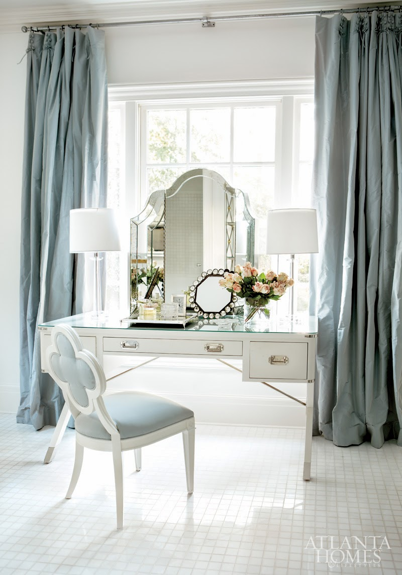 White vanity with blue chair and curtains via Atlanta Homes