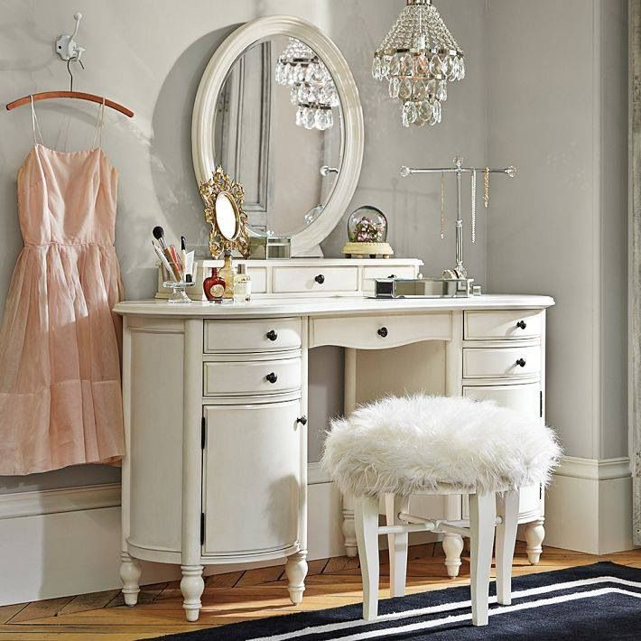 White vanity with fur stool and crystal chandelier