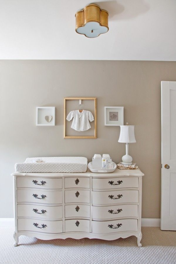 White vintage french dresser as baby station