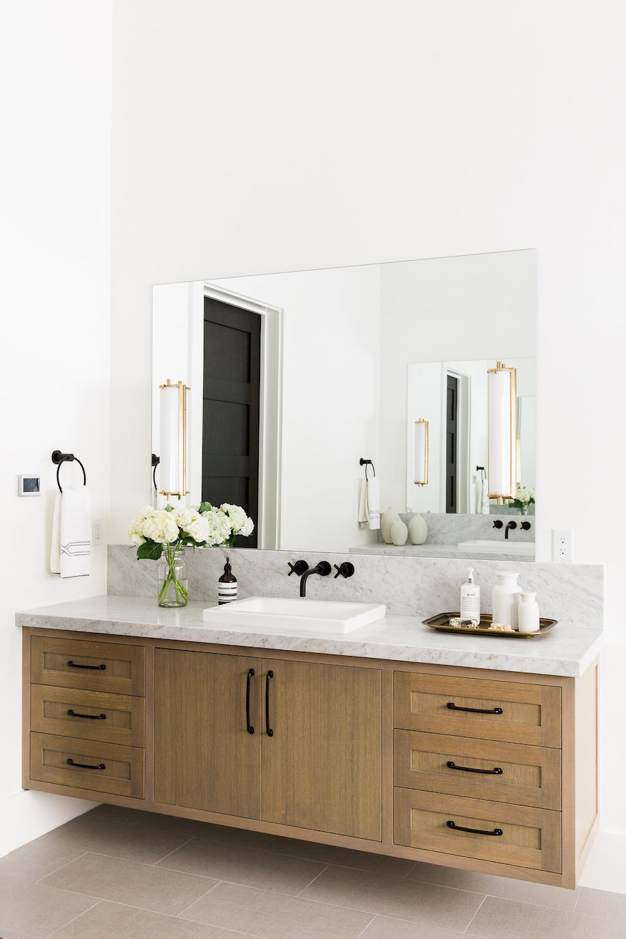 Wood Vanity with Marble countertop and Black Faucet