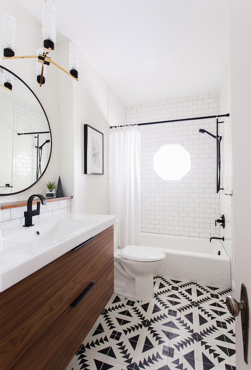 Bathroom with black and white tiling via Maggie Stephens Interiors