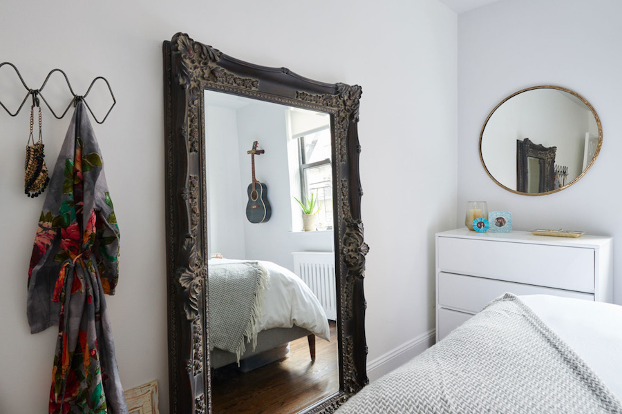 Bedroom with oversized vintage mirror