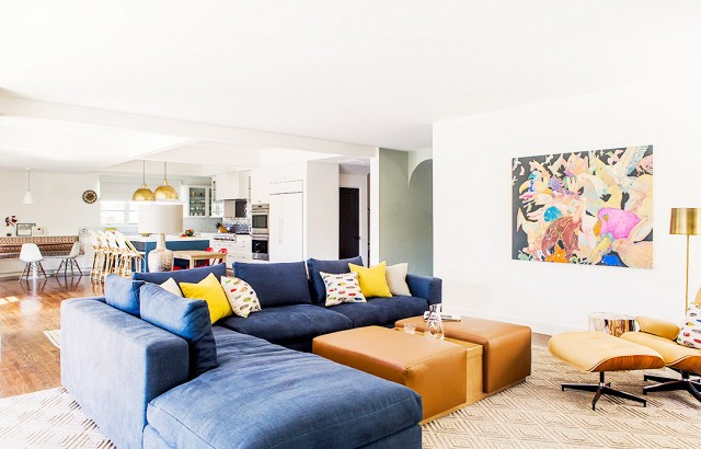 Blue velvet couch in expansive living room