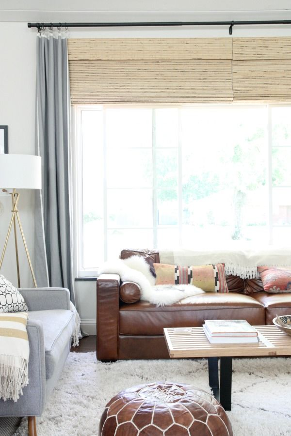 Brown leather sofa with brown poof