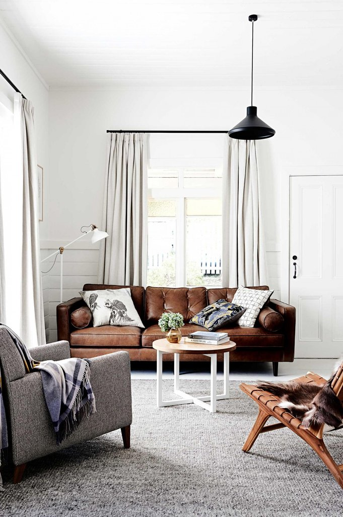 Brown leather sofa with grey rug via Dowel Jones
