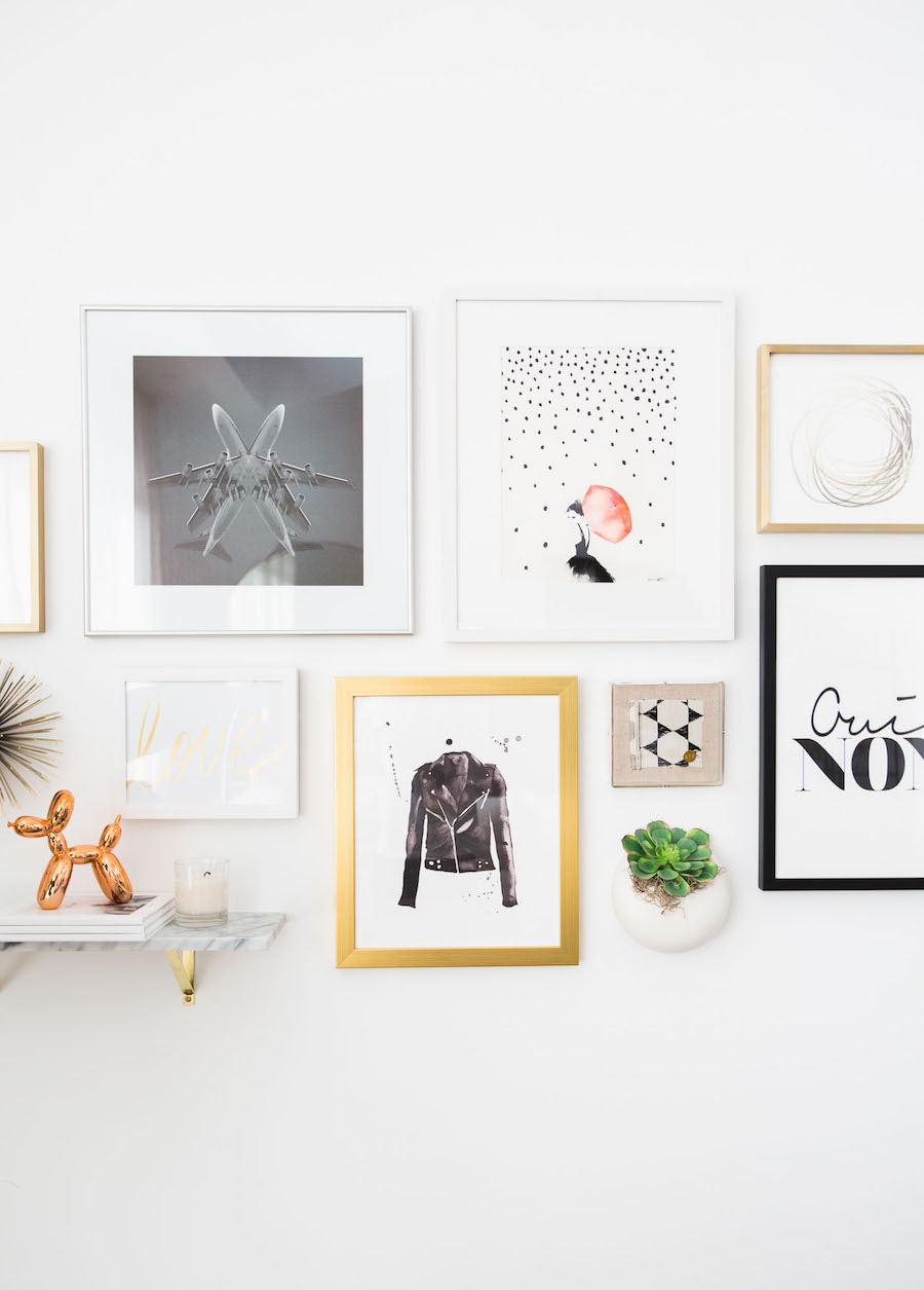 Chic gallery wall with gold frames
