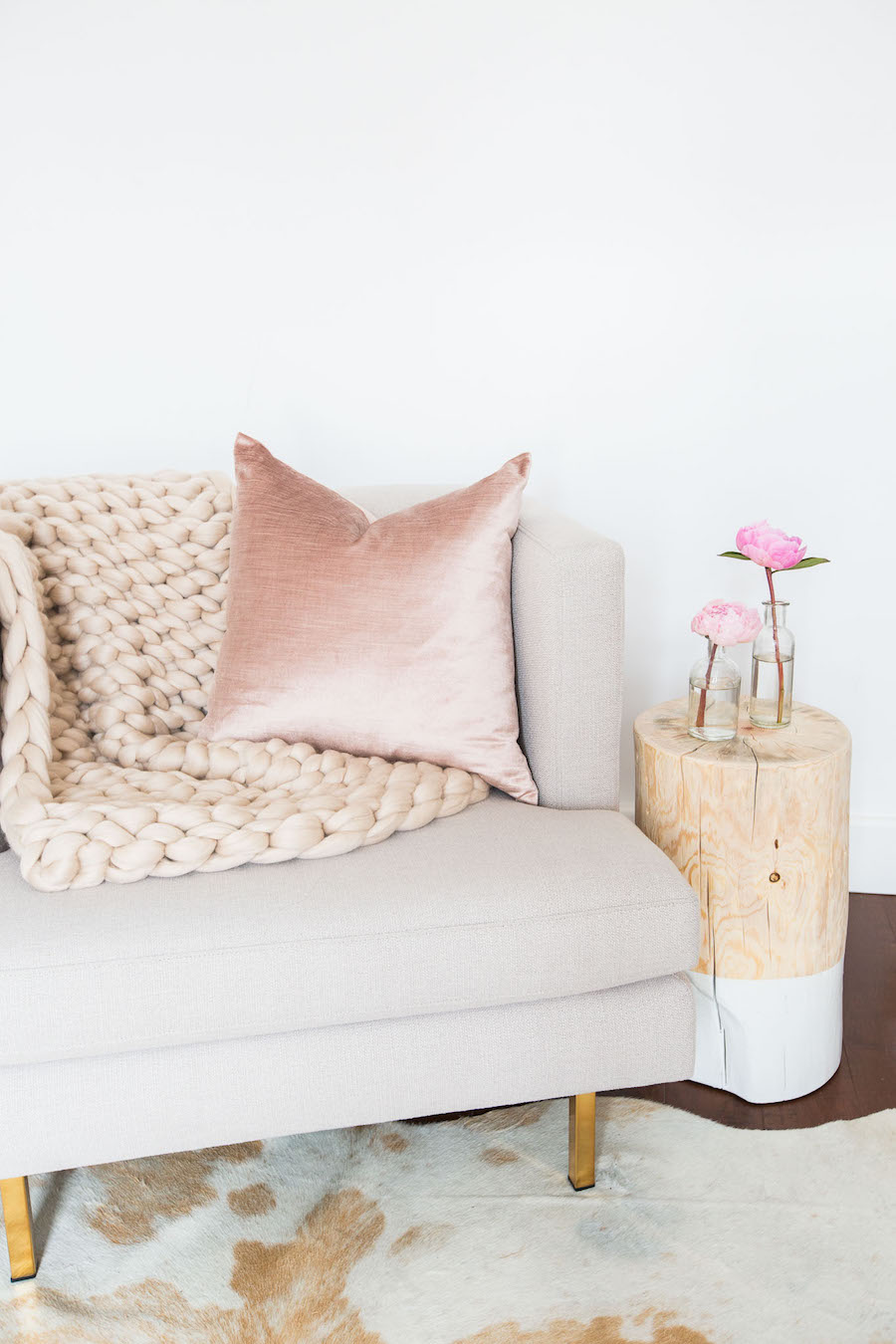 Chunky knit throw and soft pink satin pillow
