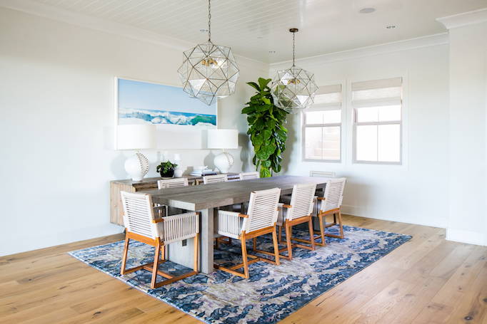 Coastal dining room with blue vintage rug