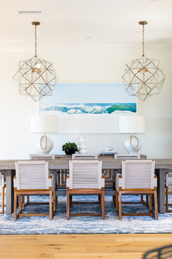 Coastal dining room with caged pendant lighting