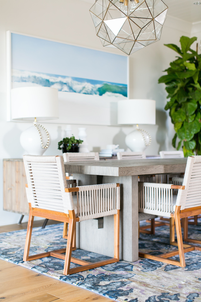 Coastal dining room with ocean artwork