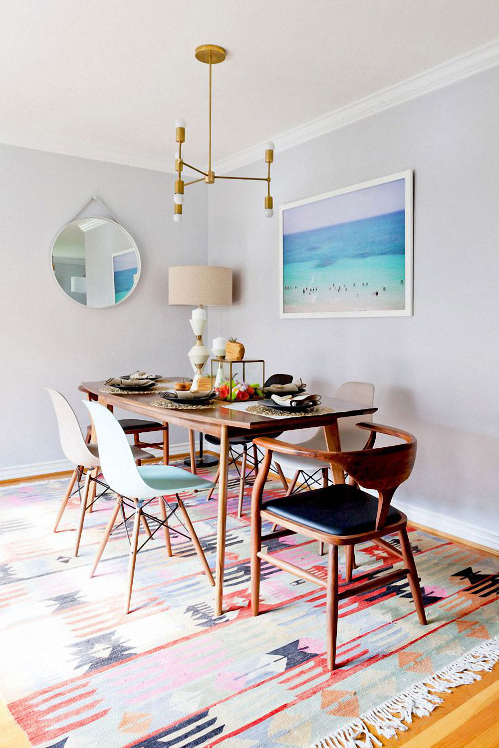 colorful dining room with mid century chairs