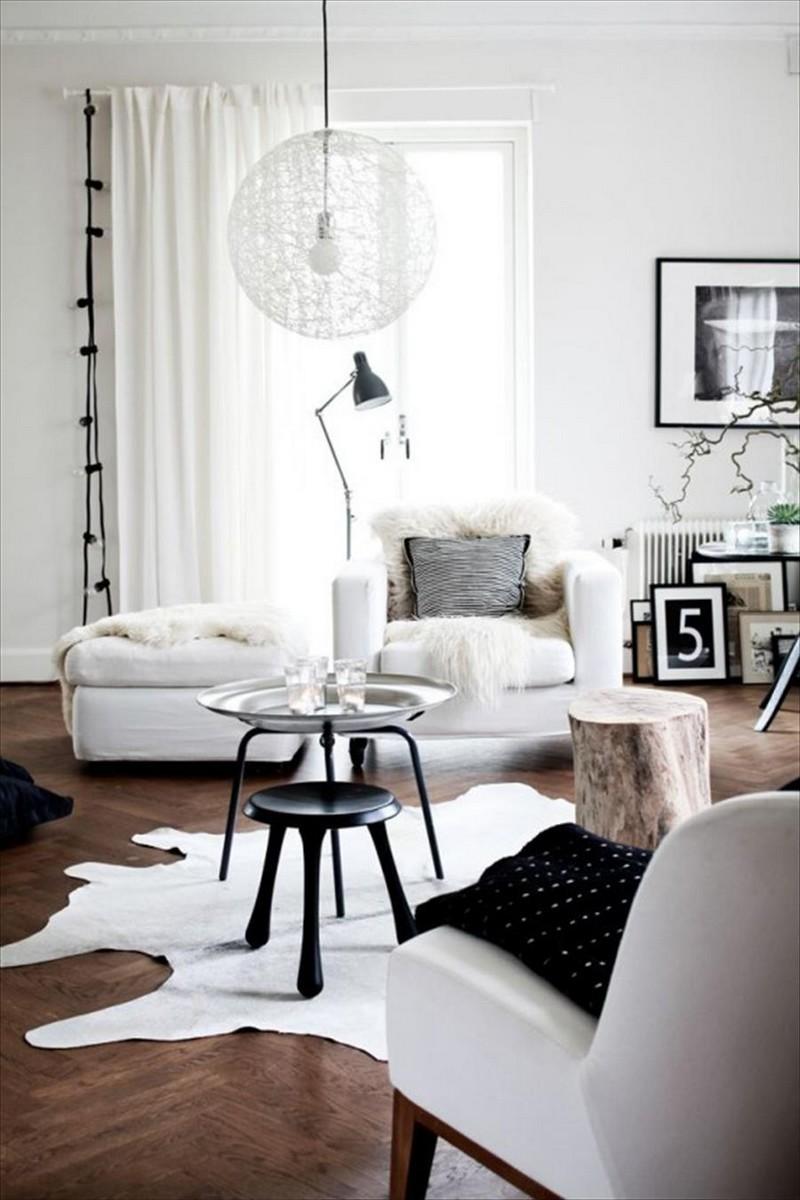 Dark wood floor living room with light color furniture