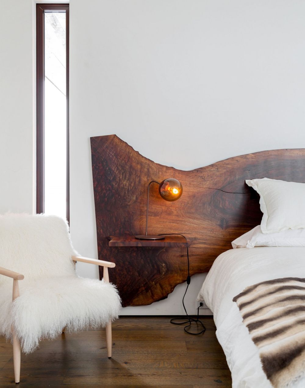 Dark wood headboard with floating nightstand attached