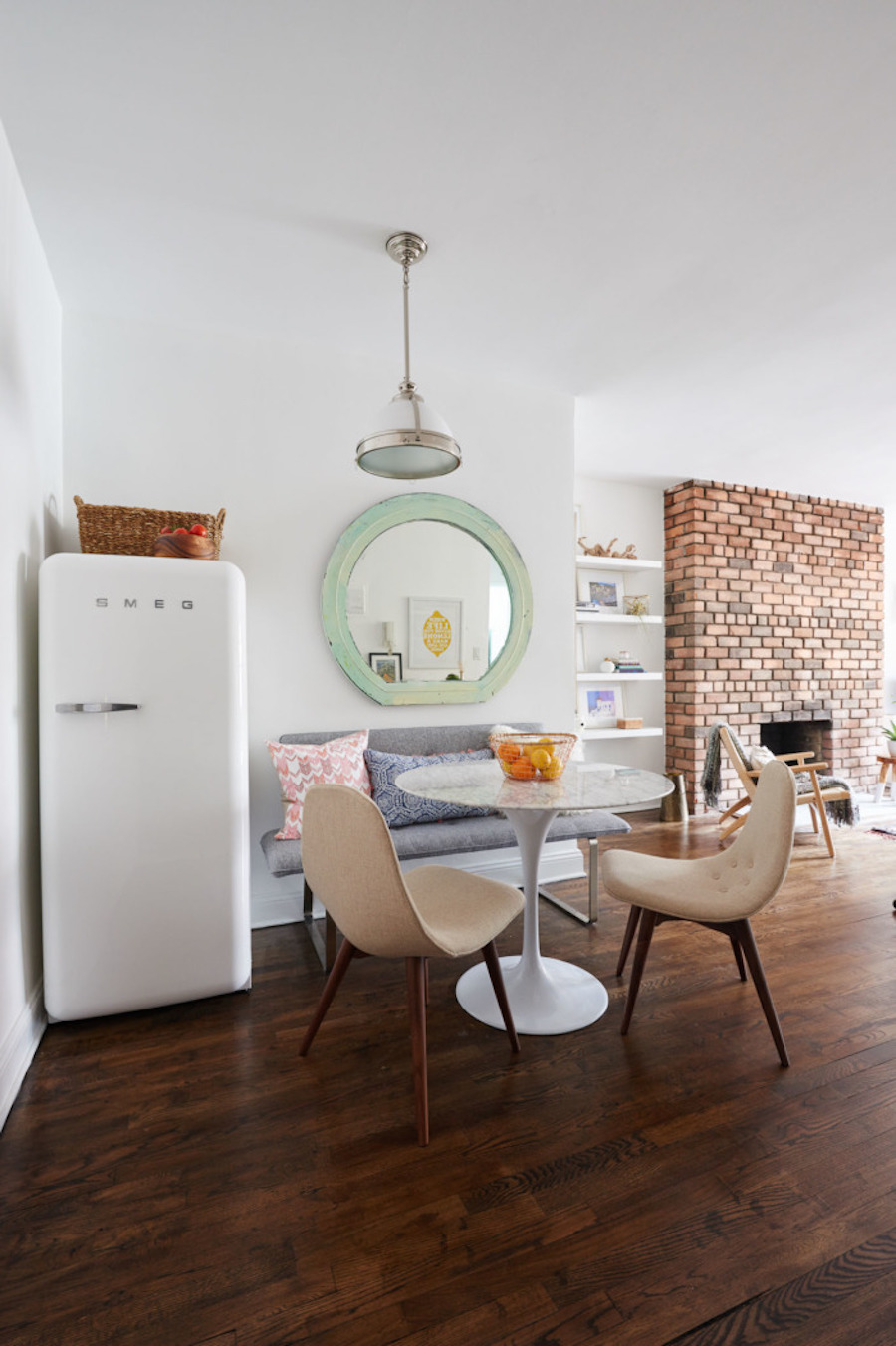 Dining nook with white SMEG fridge