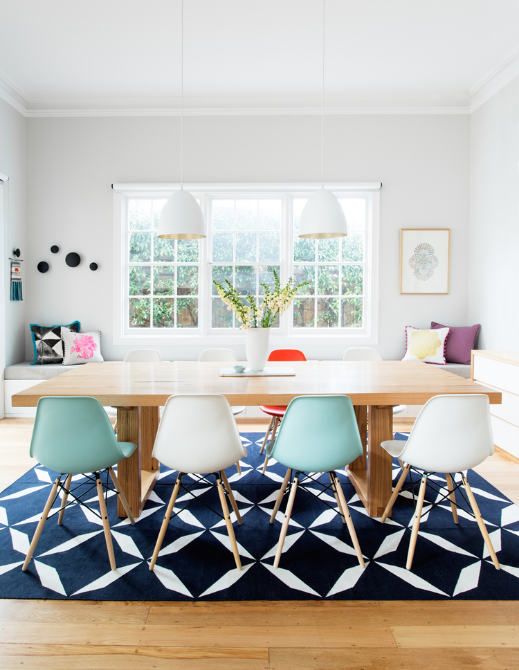 Dining room with blue and white chairs