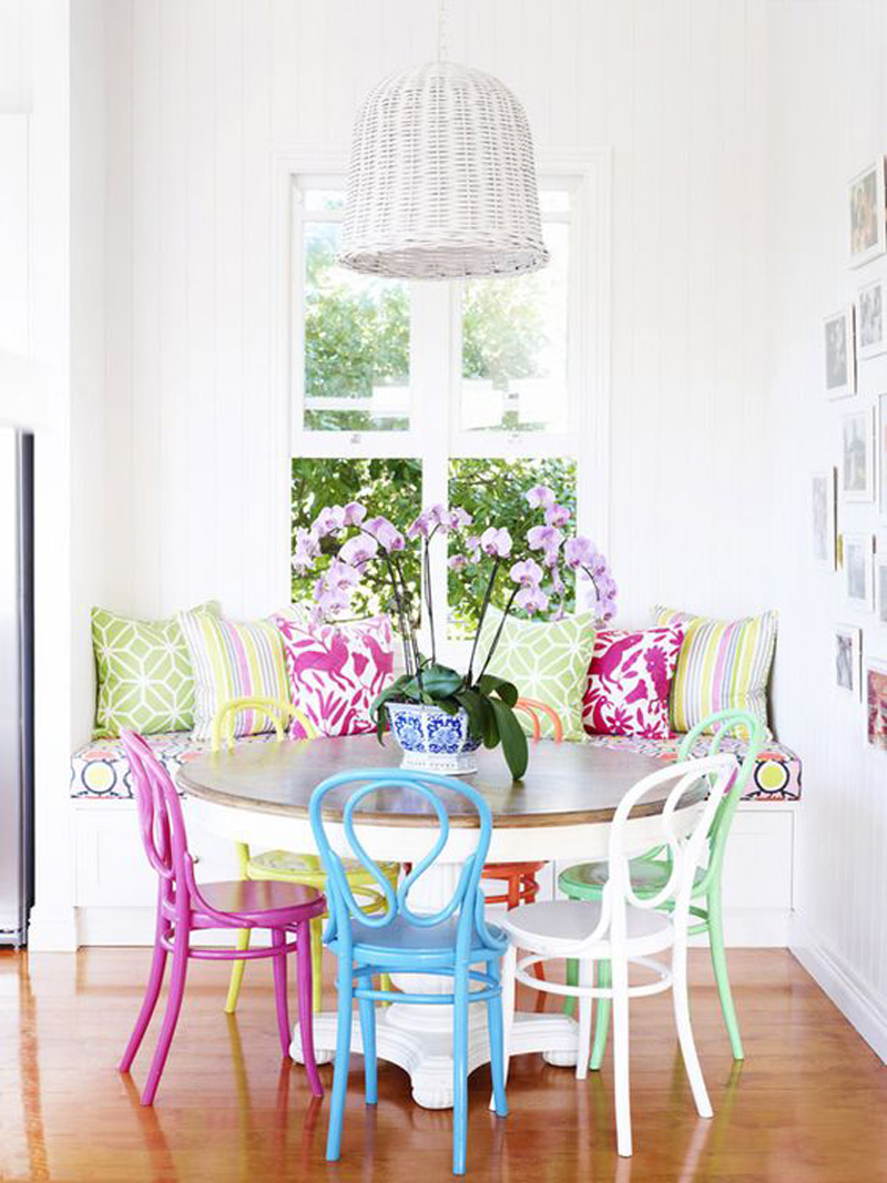 Dining room with multi-color french chairs